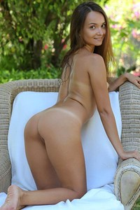 Smiling sweetheart Veronika Benet playfully poses outdoor baring her hot tan lines