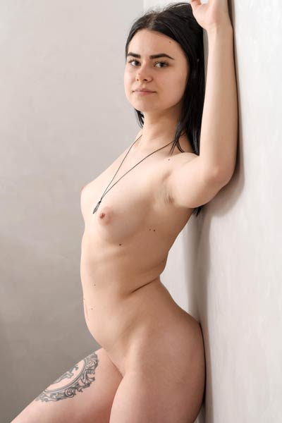 Pale skinned angel Silver Leen poses naked on silk and shows off all she has