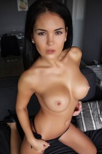 As she drops her bra her huge firm tits are presented