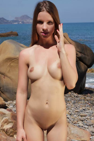 Lovely Amanda displays her perfect naked firm body for an outdoor photo shoot