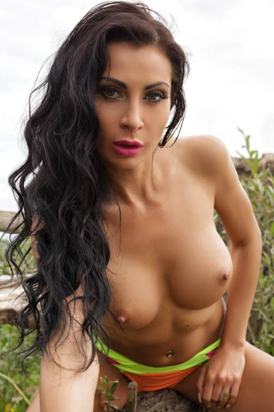 This sexy busty babe strips down naked for an outdoor photoshoot
