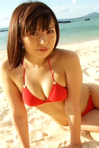 Uki Satake posing for you on the beach packed up in red bikini