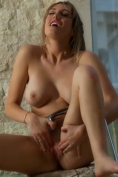 Magnificent busty blonde mastuurbates under the shower orgasms intensively