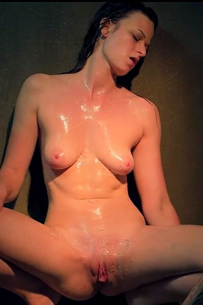 Monna Dark got horny under a shower and starts to rub her wet clit intensively
