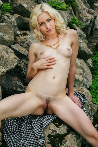 Outstanding blonde Janelle B flaunts her yummy naked body while posing outdoors