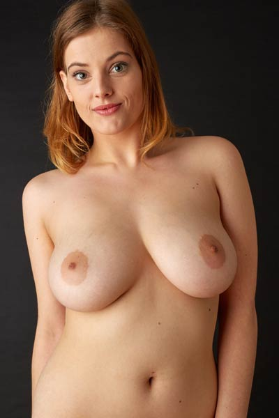Delina G has a pair of huge natural breasts which she shamelessly displays