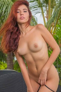 Amazing redhead looks amazing without her bikini and with a dildo in her moist vag