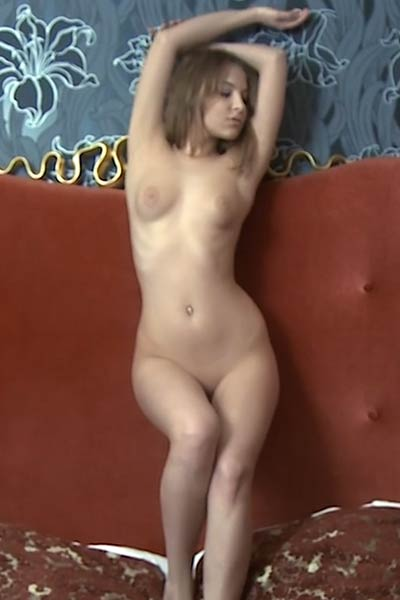 All natural sweetheart Nikia shows off her sexy slender body in the bedroom