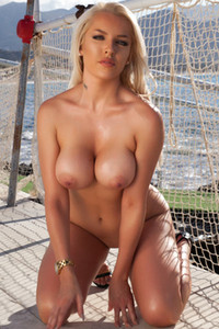 Irresistible blonde babe strips her bodysuit outdoor and dazzles us with her hot sex assets