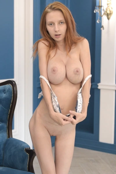 Helga Grey shamelessly strips down and squeezes her firm large boobs in front of a camera