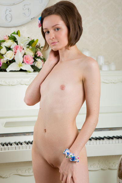 This small kinky babe Caramel slowly strips and unveils her yummy naked body