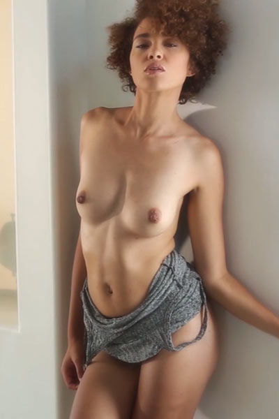 Curly haired Ebony Sheila J looks irresistible while slowly taking off her clothes