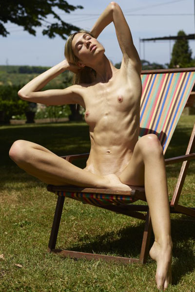 Blonde goddess Francy presents her athletic body as she poses naked outdoor