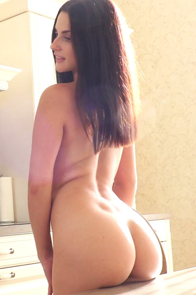 Wonderful little babe enjoys parting her firm legs for her muff to be seen