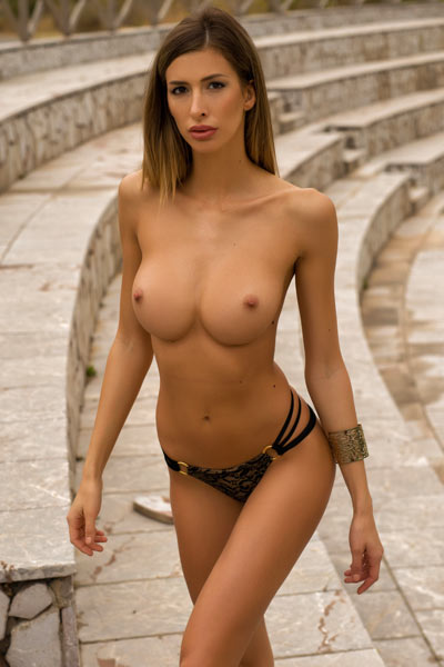 Claudia looks amazing while posing naked and presenting her perfect pair of breasts