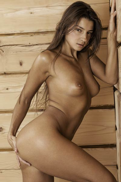 Gorgeous brunette doll exposing her amazing natural curves