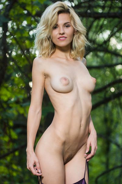 Elegant blonde babe Zarina A plays with her fingers and makes her pussy all wet in forest