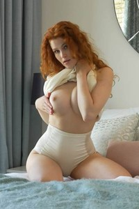 Bloomed angel Heidi Romanova bares her smoking hot body in Ginger Babe