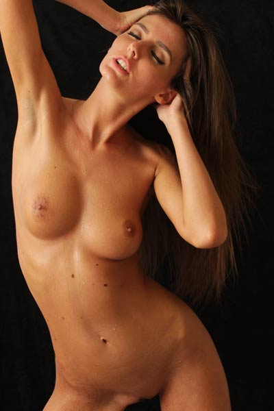 She peels off her clothes unveiling her firm round tits and outstanding figure