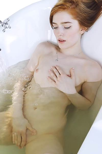 Redhead goddess enjoys her bath time and shows us her beautiful pale body