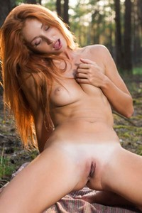 Seductive ginger babe Michelle H playfully poses in nature baring her sweet assets