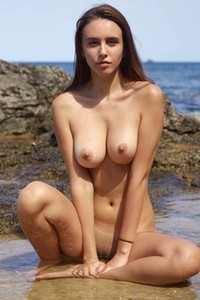 Take your clothes off and get wet with busty brunette hottie