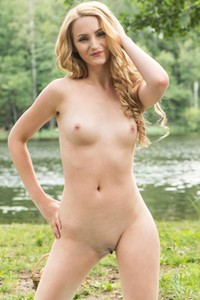 Leda A takes her colorful dress off revealing her skinny body on the riverside