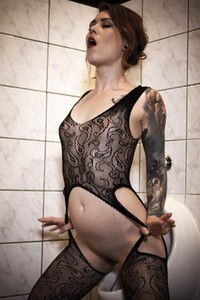 Foxy Sanie strips down to her very revealing bodysuit and masturbates in the toilet