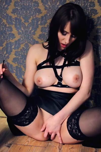 Kinky and sexy blonde vixen plays with her moist cunt in front of a camera lens