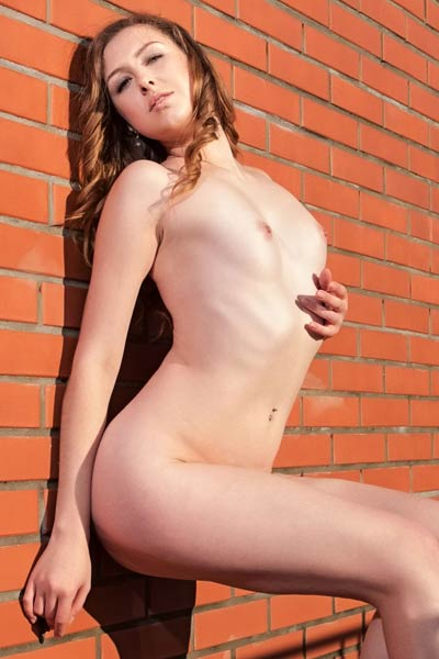 Ginger Frost is outdoors all naked teasing in many different poses
