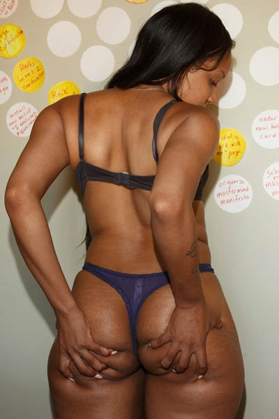 Amazing Ebony with a big round ass slowly strips and awaits your attention