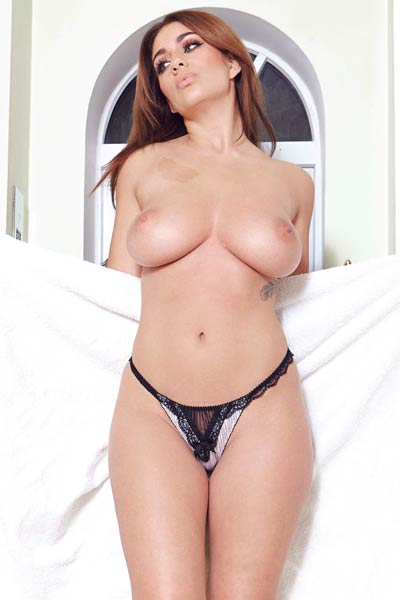 Wonderful Holly looks outstanding while posing in her sexy lingerie and teasing you with her boobs