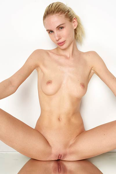 Marika shows off her skinny naked body for a photo shoot