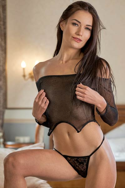 Tall and beautiful model takes off her sexy lingerie and unveils her sweet body