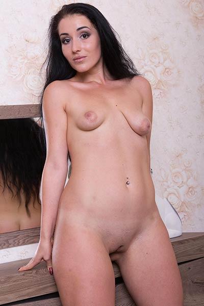 Monica F shamelessly displays her naked body for a magazine
