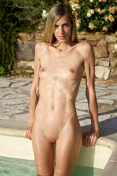 Skinny chick takes a bath in cold water making her tiny nipples erect