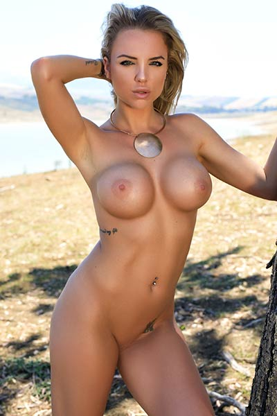 Glorious blonde Brittie bares her large round tits for an outdoor photo shoot