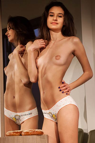 This young vixen is a bit shy but in the end she has shown her naked body