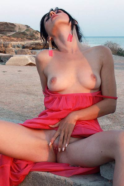 Top class hottie in pink dress showcasing her attributes on her secret place