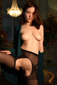 Young and sweet babe poses in crotchless nylons showing off her hot sex assets