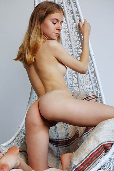 Skinny newcomer Shayla takes off her blue dress revealing her naked body