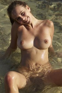 Young cutie Alisa poses naked in the lake showing off her amazing big tits and pussy