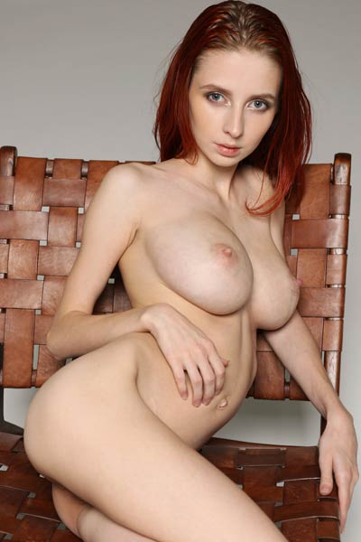 Petite redhead babe with amazing big boobs shows off all she has