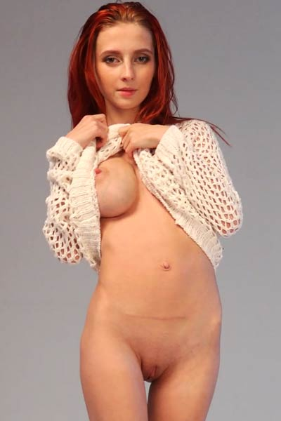 Pale skinned redhead beauty presents her massive boobs and hot pink pussy to you