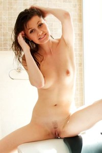 Carmela A taking a bath and plays with her boobs and pussy