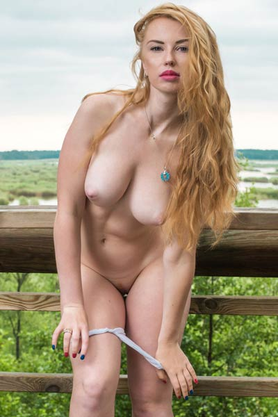 Incredibly hot Helene poses naked outdoor and presents her amazing curvy body