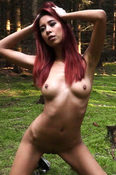 Incredibly hot slender babe Paula Shy sprawls her naked body on the grassy lawn