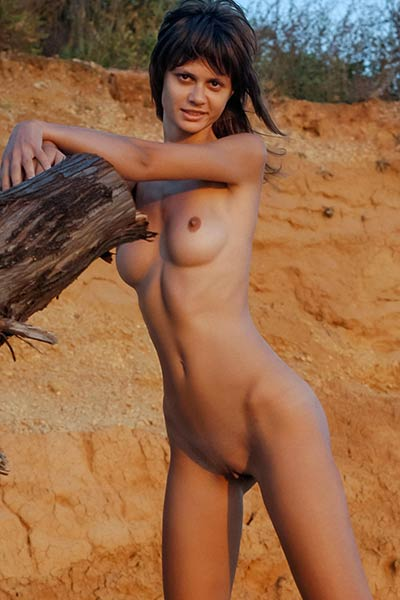 Nika R is outdoors on her secret place showcasing her skinny body