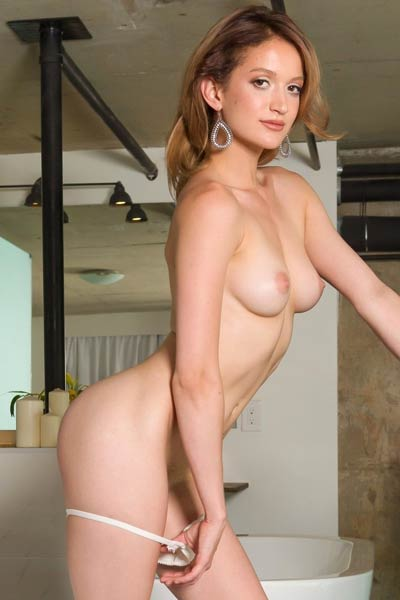 Delightful blonde Dakota Burd flaunts her sexy body and shaved pussy as she poses