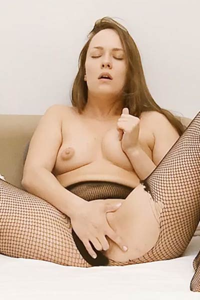 Blue Angel tears up her black fishnets and fingers her love hole on the couch